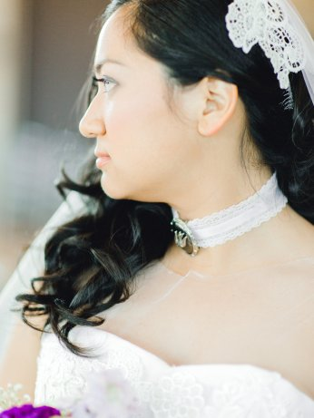 Detail shot of lace, choker, and hairpiece.